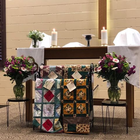 altar, quilts, flowers